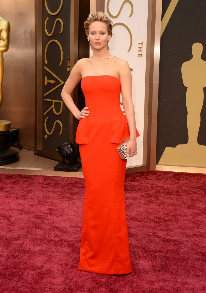 Jennifer Lawrence works that beautiful short hairdo with this amazing Christian Dior bright red strapless peplum gown. She wore a backwards diamond necklace and shows us that repeating a similar style from last year only endears us to her even more with this triumph of an ensemble!