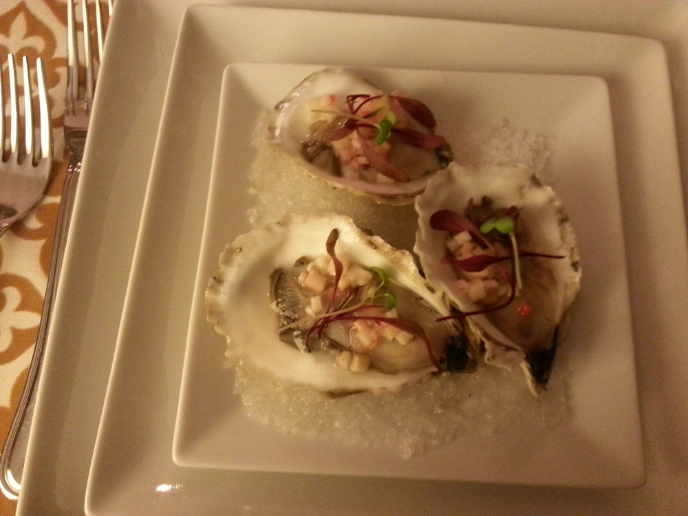 Oysters on the half shell with quick pickle,  bull's blood shoots