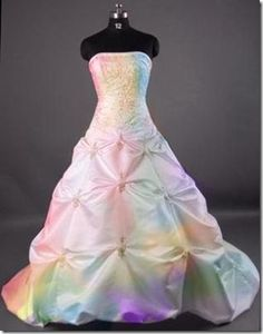 Subtle rainbow hues to this Wedding Gown make it work and not go overboard.