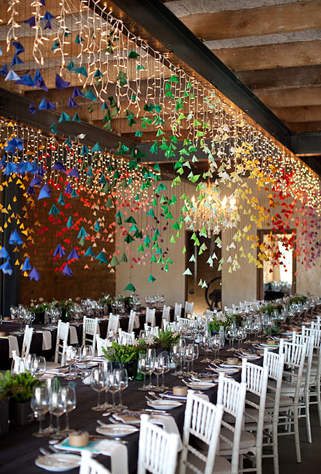 Rainbow hued paper banners really add another dimension to this decor.