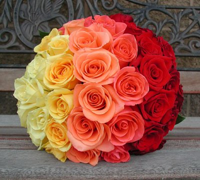 A rainbow toned wedding bouquet.