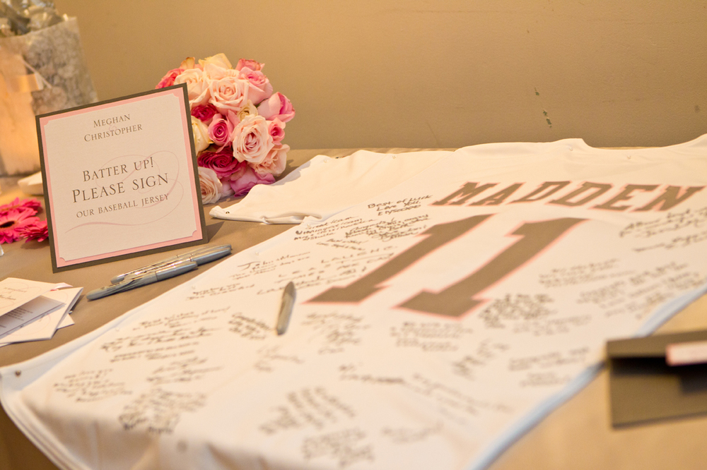 Instead of a traditional guest book, guests signed a baseball jersey.