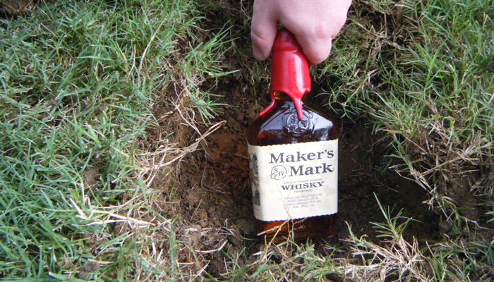 Burying the Bourbon is a Southern Tradition to prevent rain on the wedding day. Does it work? Ask the bourbon!