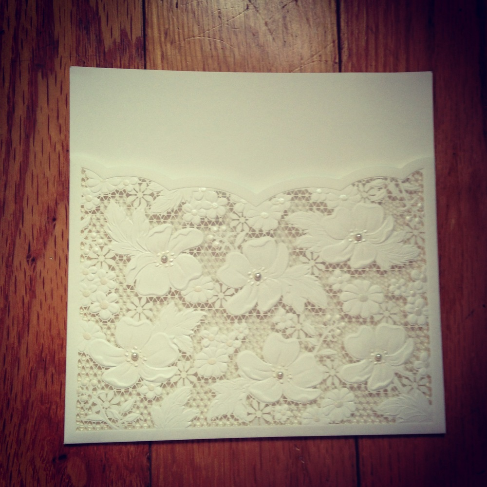We carry these beautiful paper lace pockets for your invitation or menu card! They will be on our shop soon but in the meantime, if you are interested, please feel free to contact us for pricing.