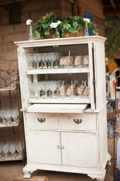 We love this idea of using an old dresser or wardrobe to house glassware for cocktail hour!