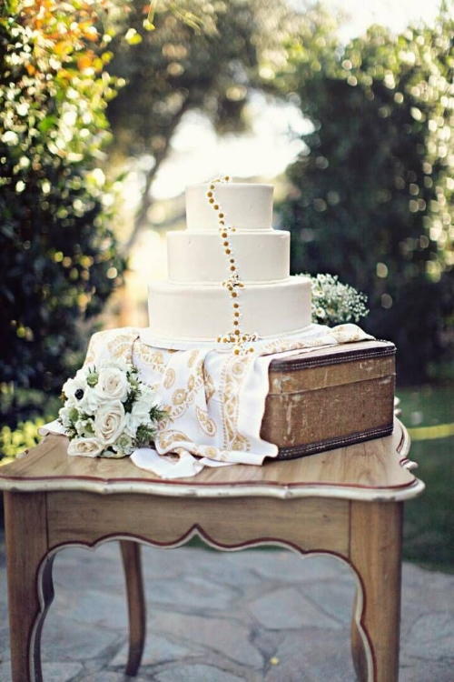 The cake is the star and the vintage suitcase and beautiful table create the perfect look for this sweet wedding cake!