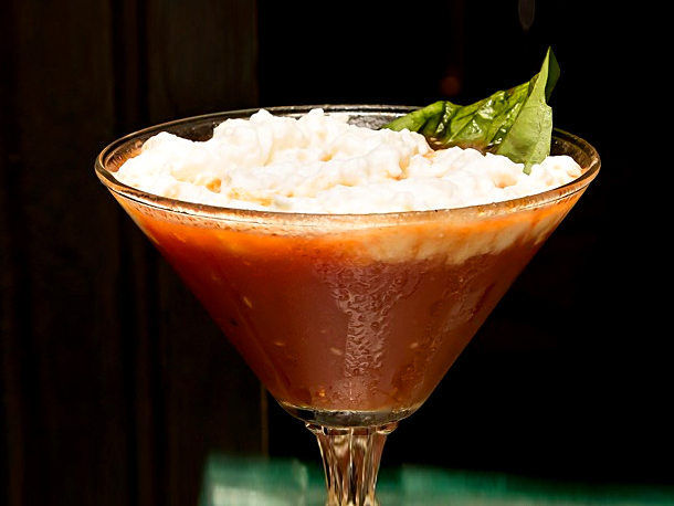 This one is called the Pizza Martini! This contains house-made basil-infused vodka, tomato juice, aged balsamic vinegar, house-made ghost pepper infused vodka, roasted garlic, fresh basil, porcini mushroom powder and it is topped with a mozzerella & Parmigiano cheese foam!  (Photo credit:  Trattoria Neapolis )