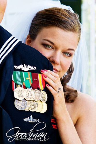 This is a great photo of a proud bride and her Navy sailor groom!