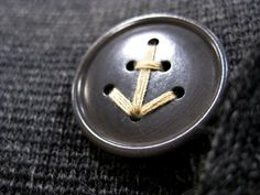 We think this anchor detail sewn through the button would be a fabulous detail on a bouquet!