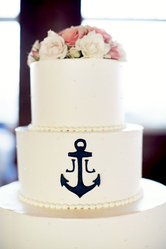The anchor detail on the wedding cake is befitting any great miltary couple!