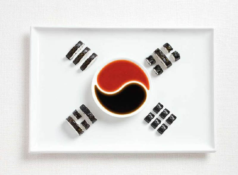"This is not really an appetizer per se, but the Korean Flag made of ""Kimbap"", Soy Sauce and ""Gochuchang"" (Korean Spicy Pepper Paste) is so eye catching and immediately signifies what country this plate is from!"