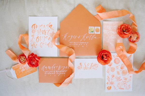 This orange invitation suite is just delicious! I especially love the white ink on the envelopes!