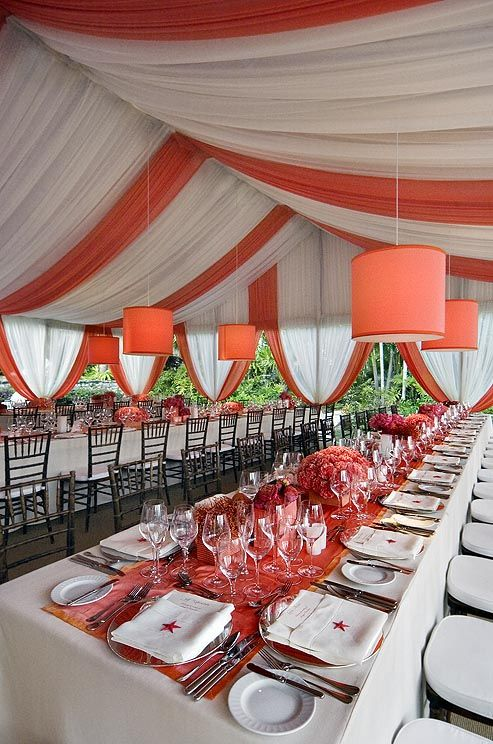 This orange and white tent is cool and casual but full of personality!