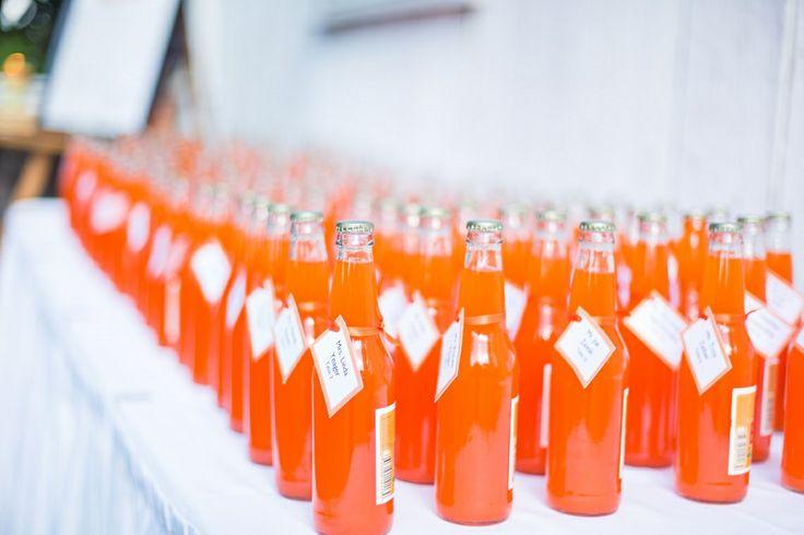 An orange soda pop escort card table? Yes please!