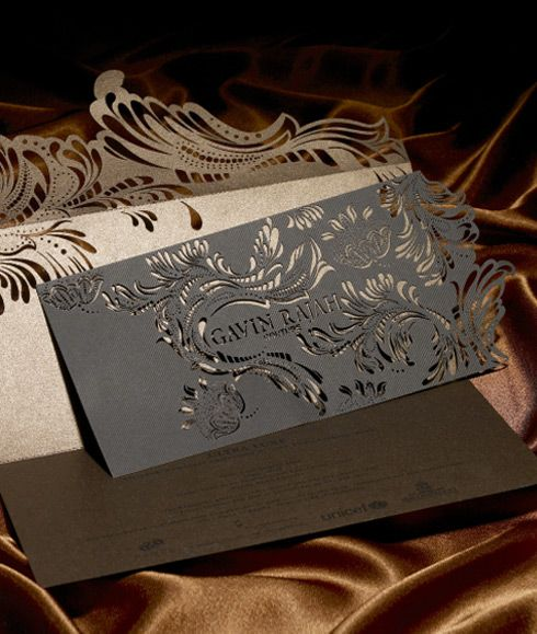 This invitation was designed for Fashion Week for Gavin Rajah. Doesn't it just exude elegance from the intricate cuts to the deep and delicious paper colors?