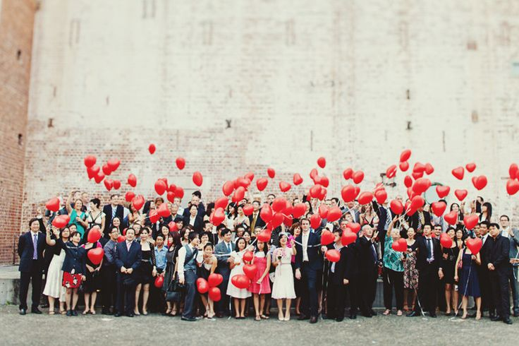 What a great group photo idea with red heart balloons. It adds an instant touch of whimsy and brightness to this photo that makes us smile!
