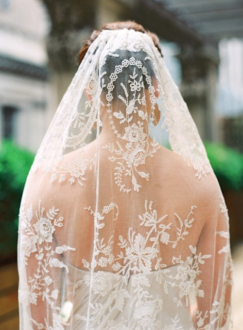 A classic and beautiful wedding veil completes the wedding look for this bride.
