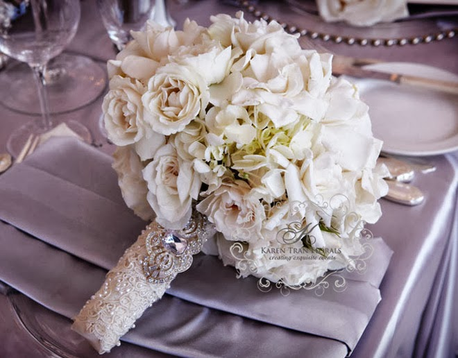 If you have some extra lace from your dress, using part of it for the handle of your wedding bouquet is a great place to show a little texture.