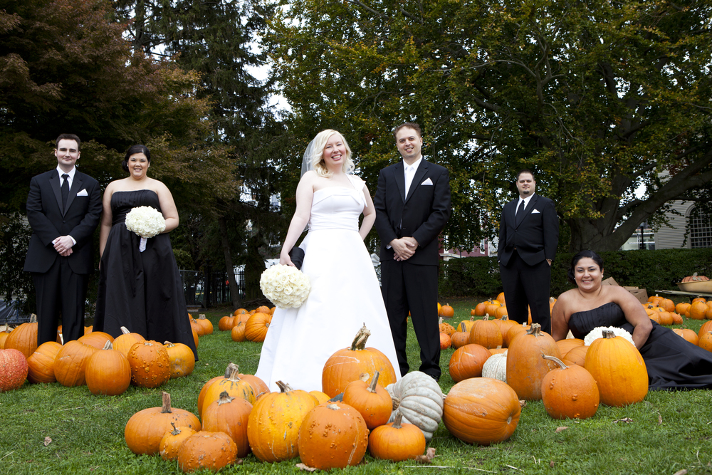 Last but not least, we love this photo taken by Kristin Spencer with one of our favorite couples and their wedding party chilling out in a pumpkin patch.