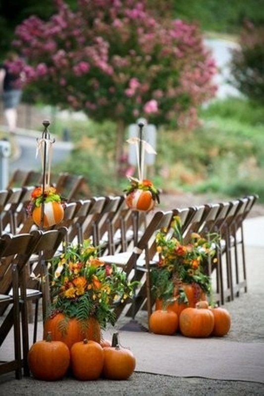 We love that pumpkins were used to mark the end of the aisle and also used as a container for the floral arrangments AND hanging as well! So lovely!