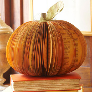 This pumpkin centerpiece is made of a book! This would be perfect for a fall wedding in a library, don't you think?