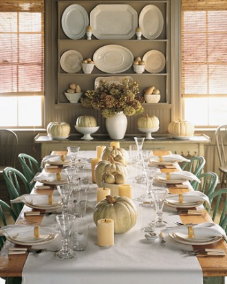 White pumpkins are so versatile in their neutral tone! We love how they are centered on this table with white pillar candles. Simple, elegant and fall all in one!