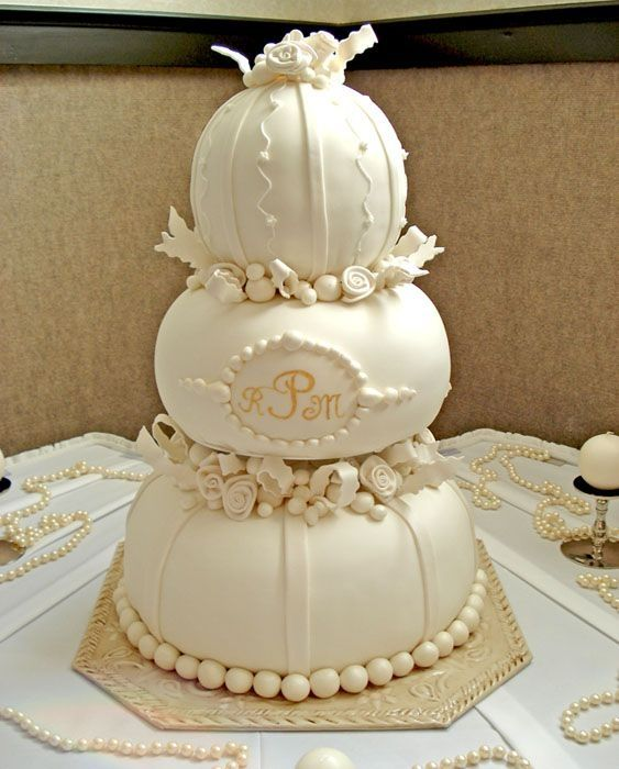 This wedding cake is so elegant in the creamy shades of white and the pumpkin shape.