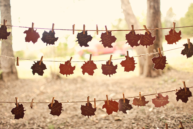Autumn Leaf Escort Cards  - We love that the Father of the Bride cut out these leaves and love the use of them for escort cards. This is a labor of love that is a great detail for an event! (As long as you have patience and sharp scissors!)