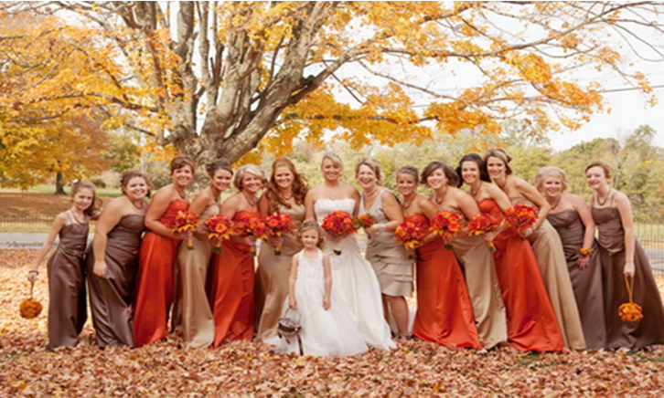 Autumn inspired Bridesmaids Dresses  - We love how the colors of the bridesmaid dresses are coordinated with fall! What a great and fun way to include a LOT of ladies without having them all in the same color!