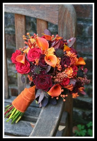 Autumn Wedding Bouquet  - This bouquet has all the great elements to make it a beautiful bouquet for a bride or for bridesmaids. We love the jewel tones and the berries in this textured and stunning bouquet!