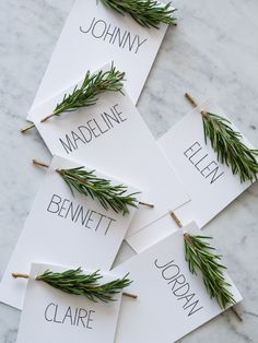Rosemary Place Card - cutting slits in a card and then weaving Rosemary through it is simple and elegant. You could do this with other woody herbs or maybe even carefully place winterberry through the card for a lovely look.