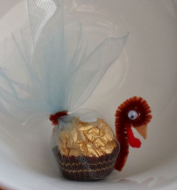 Ferreo Rocher Turkey Place Card  - I love these little chocolate and hazelnut candies and making them into a Turkey is so whimsical. Be careful if you have guests with nut allergies as these candies do contain nuts.