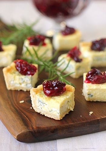 Blue Cheese Tart with Cranberry Chutney - These delicious bites can be made ahead of time. We love the touch of cranberry chutney on the top of these bites - they look like little jewels!