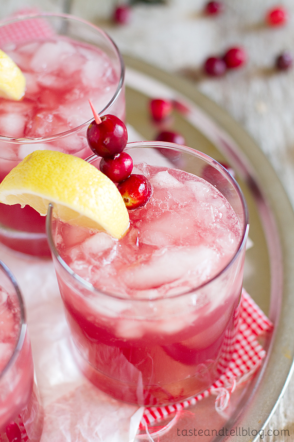 Sparkling Cranberry Punch  - this punch looks festive and fun and is so easy to make! Cranberries are easy to find and if you freeze a bag before they can help keep the punch cool!