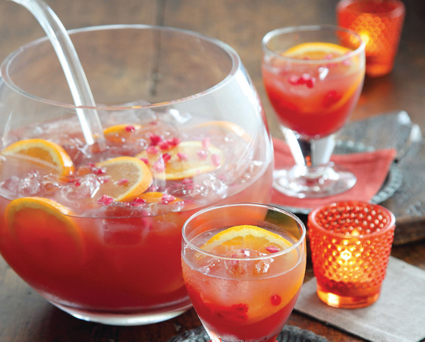 Orange Pomegranate Sparkling Punch - this punch LOOKS like what Thanksgiving is supposed to be - warm, bright and inviting! There is something about oranges that always feel friendly and happy!