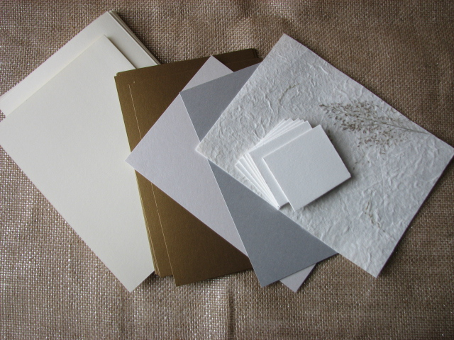 Folded Blank Greeting Card, flat colored cardstock, White cardstock for the plate, silver cardstock for the silverware and text weight paper for the napkin.