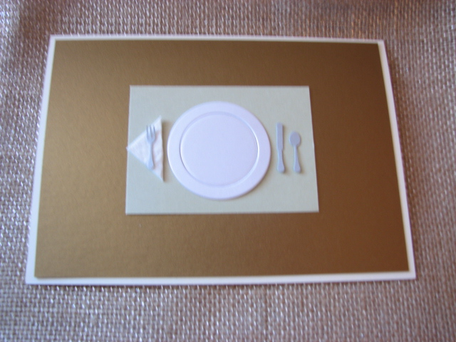 "I glued on the ""napkin"" and ""utensils"". The place setting is finished."