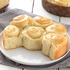 King Arthur Flour's Buttery Sourdough Rolls - There is nothing more lovely than a delicious and brown dinner roll with a soft and warm inside to slather butter on. These rolls will make you think you died and went to roll heaven!