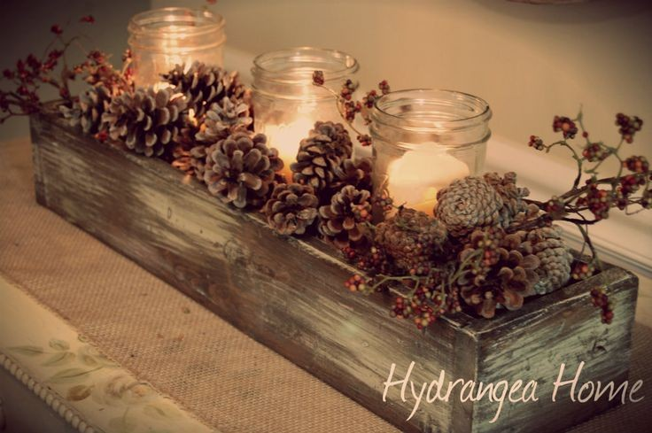 Pine Cone Centerpiece - DIY - This is a great and easy arrangement to make using mason jars, candles, winterberry and pine cones! We think there are endless variations that you could do on this theme!