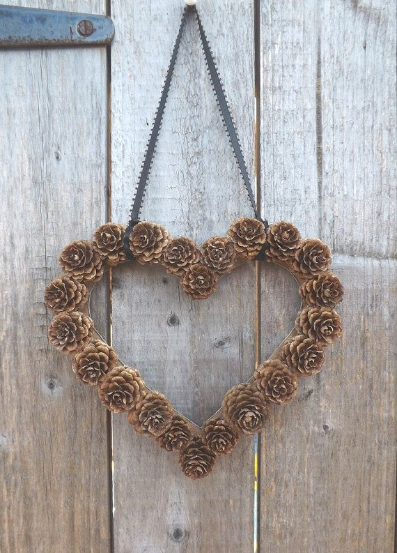 DIY Pine Cone Heart - Pine Cones are a great material for wreaths. We love this heart wreath for a wedding!