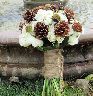 Pine Cone Wedding Bouquet - We love so many things about this bouquet - the pine cones, the rope handle, the fiddlehead ferns and the creamy white roses!