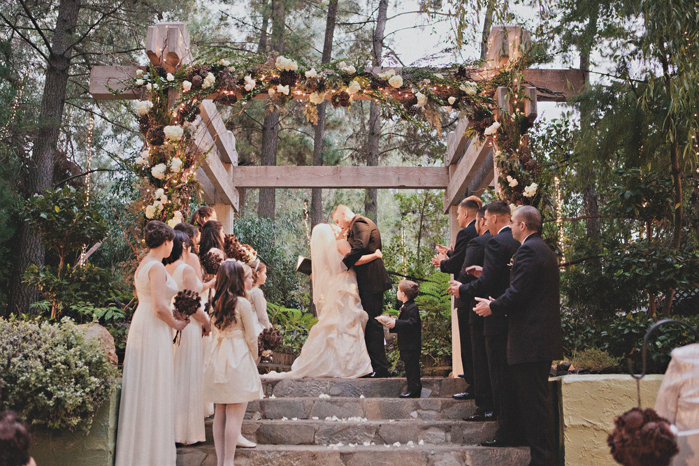 Pine Cone Wedding Ceremony - This exquisite wedding is so striking with the natural arbor strewn with pinecones, flowers and great greenery!