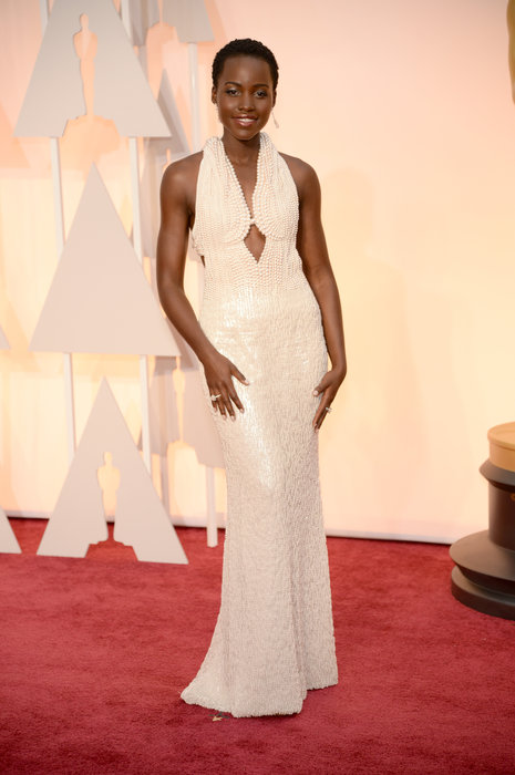 Actress Lupita Nyong'o in custom Calvin Klein Collection and Chopard diamond drop earrings.jpg