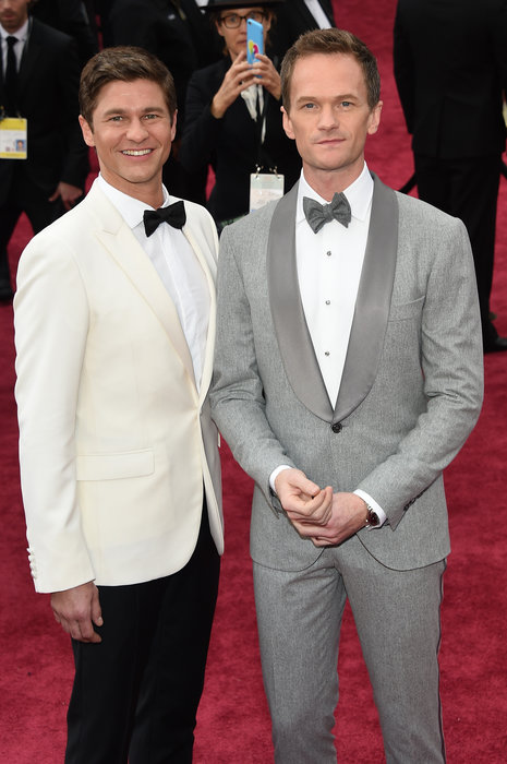 Host Neil Patrick Harris (R) is wearing a Brunello Cucinelli tuxedo and tie and David Burtka is wearing a Calvin Klein Collection tuxedo.jpg