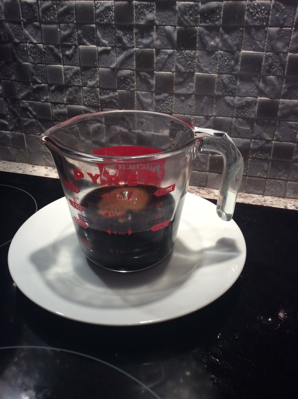 Pour the cola syrup into a heatproof glass container.