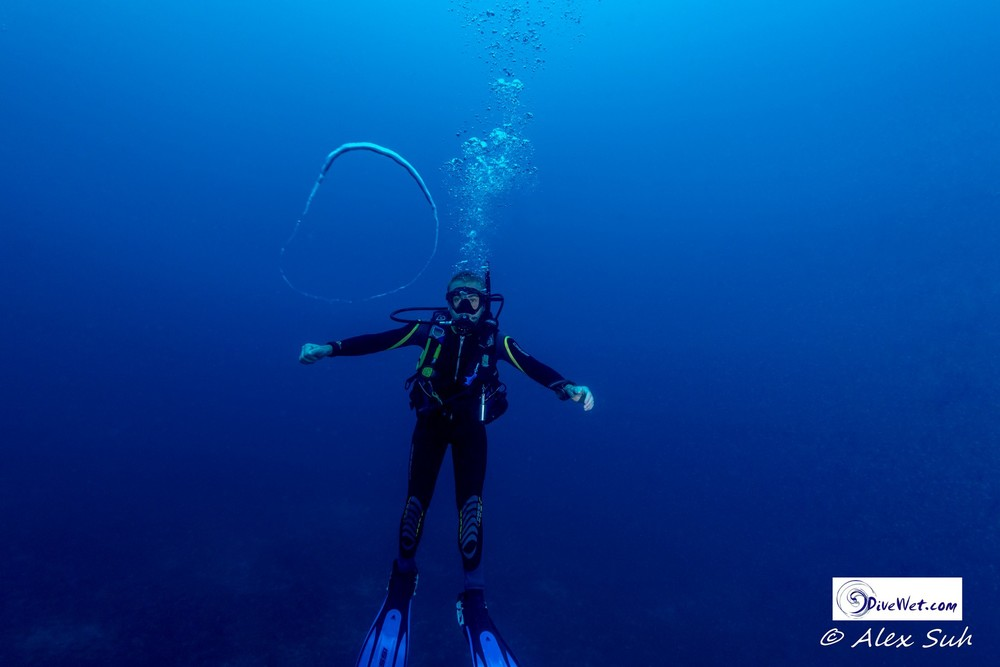 Jamie, A Dive Instructor, Blows Water Rings