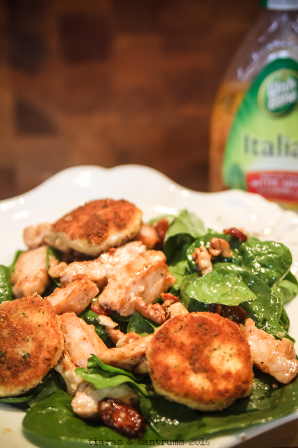 AD Easy Spinach Salad - spinach, chicken, bacon, walnuts, goat cheese  and a warm Italian dressing that you can shake up in a jar! This recipe is ALWAYS a hit with my son! Easy and delicious, meets all your needs! | tiarastantrums.com/blog/spinach-salad-with-goat-cheese-bacon-walnut-and-warm-italian-dressing #OneBowlWonder