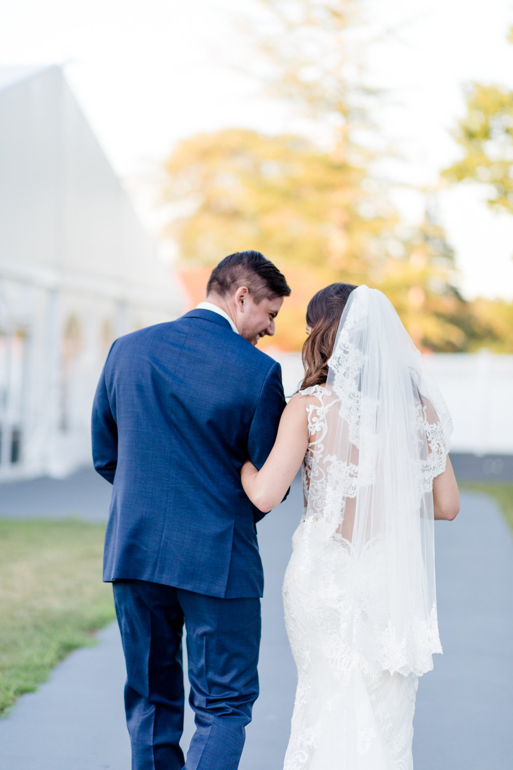 """Dione + David share a laugh moments after saying """"I do"""" at their Villa at Ridder Country Club wedding (East Bridgewater, MA)"""