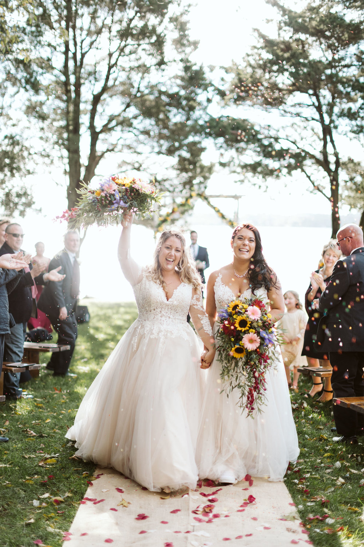 Rachel + Chelsea celebrating their first moments as newlyweds at their Mount Hope Farm wedding (Bristol, RI)