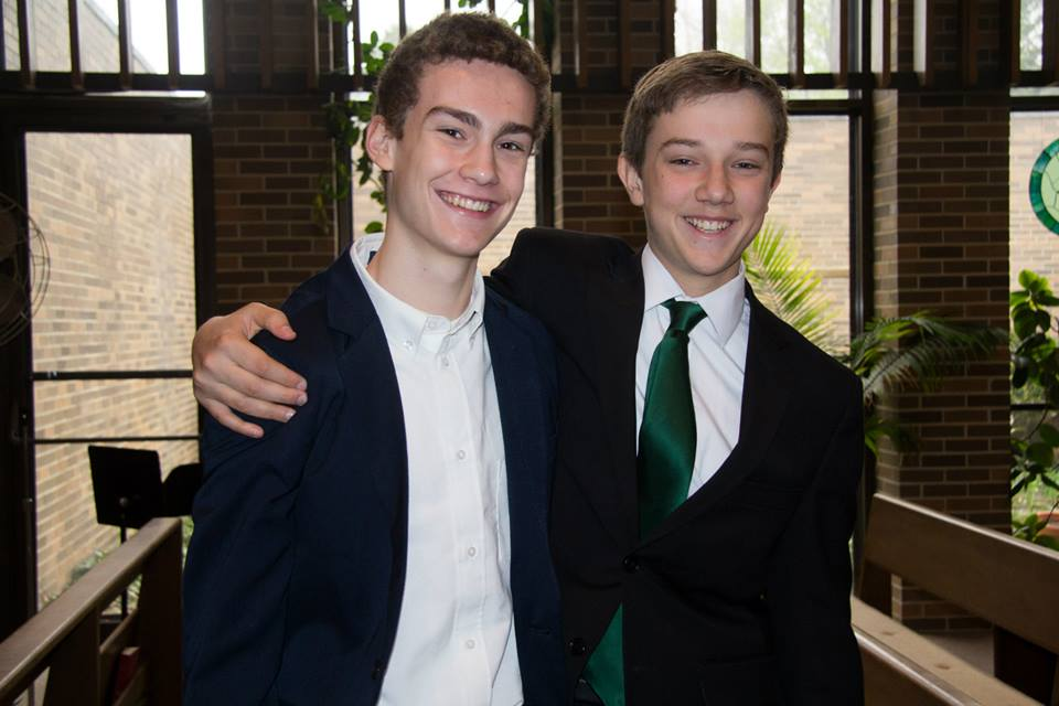8th graders Matthew and Edward celebrate their presentations. Photo by Tami Barbour